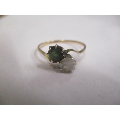 10 - A 9ct gold diamond and tourmaline crossover ring Location: CAB...