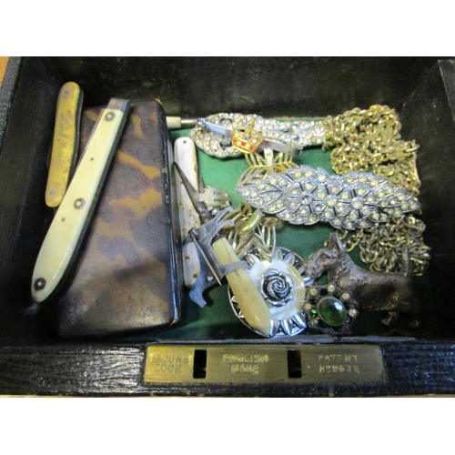 100 - A small jewellery box containing a papier-mache snuff box, gold plated and gold coloured chains, pen...