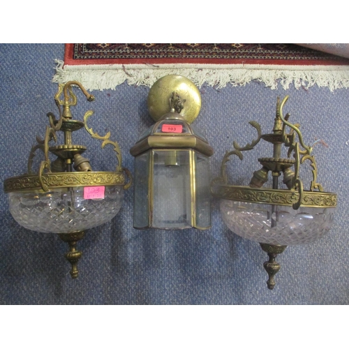 103 - A pair of 1950s brass framed light fitting with cut glass bowls and a brass framed lantern centre li...