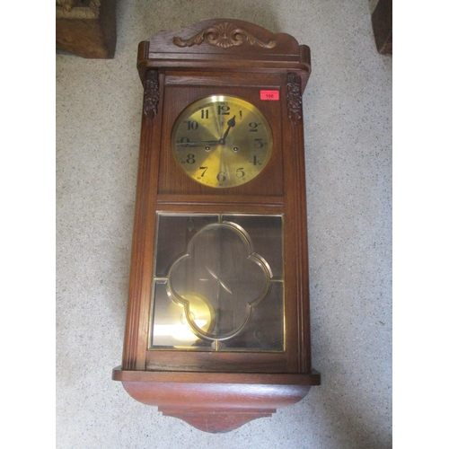 106 - An early 20th century oak wall clock fitted with an 8 day movement, brass dial with Arabic numerals ...