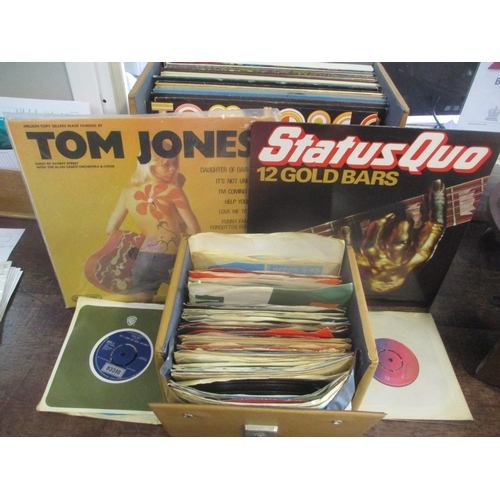 107 - 1950s and later 45rpm and LP records to include Pop, Tom Jones, Abba, Status Quo and others Location...