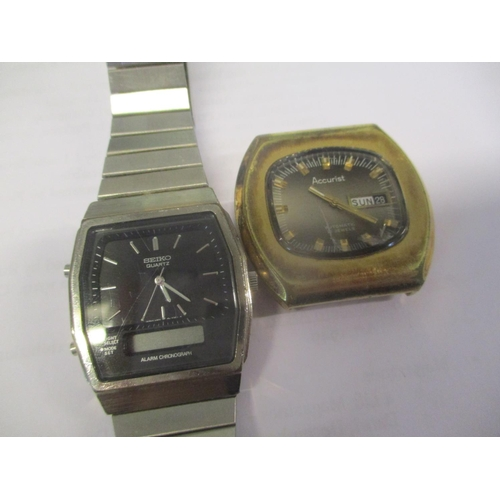 109 - A 1970s Accurist automatic wristwatch with day/date, no strap and a Seiko stainless steel wristwatch...