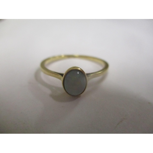 11 - An 18ct gold opal inset ring Location: CAB...