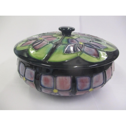 110 - A Moorcroft pottery bowl and cover decorated with geometric flowers Location: 6:1...