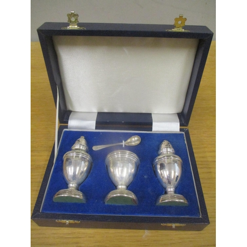 126 - A silver four-piece condiment set boxed Location: RAM...