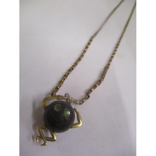 13 - A WWI Touch Wud Lucky Charm on a 9ct gold necklace Location: CAB...