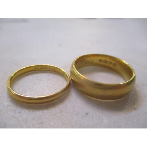 16 - Two 22ct gold wedding bands Location: CAB...