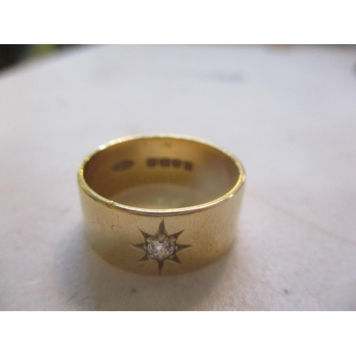 17 - An 18ct gold diamond inset gypsy ring Location: CAB...
