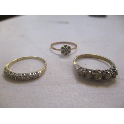 18 - Three 9ct gold rings to include a daisy ring Location: CAB...