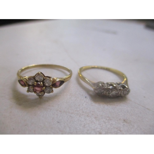 19 - An 18ct gold and platinum diamond, three stone ring, together with a 9ct gold cluster ring Location:...