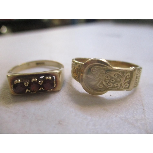 20 - Two 9ct gold rings to include a three stone garnet inset ring Location: CAB...