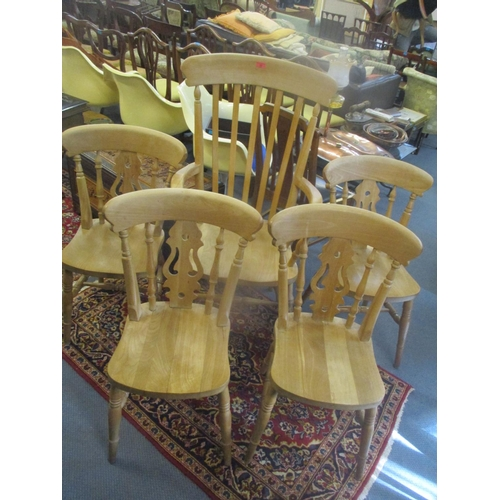 32 - Five modern country style beech kitchen chairs comprising a set of four, with a pierced splat and an...