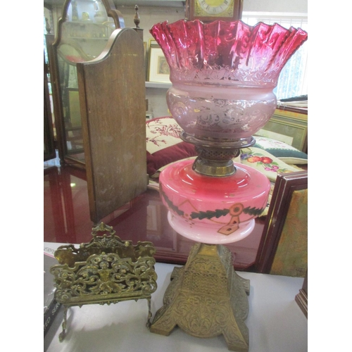 36 - A Victorian oil lamp having a painted reservoir and etched glass shade, together with a letter rack ...