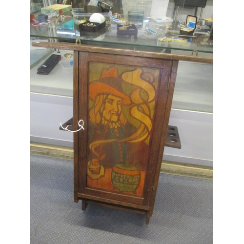 39 - An early 20th century oak wall hanging smokers cabinet Location: RWB...