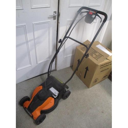 48 - A Worx cordless lawnmower Location: G...