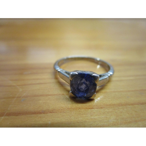 99 - An 18ct white gold and platinum set with a single purple coloured stone Location: CAB...