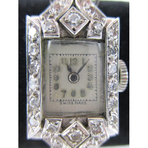 11 - An Art Deco white metal ladies diamond cocktail watch, 10mm case, unsigned with a Swiss 17 jewelled ...