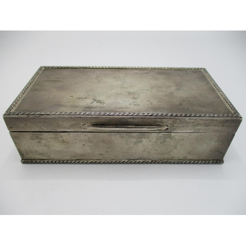 13 - An Elizabeth II silver cigarette box, London 1952, by Padgett and Braham Ltd, of rectangular form wi...
