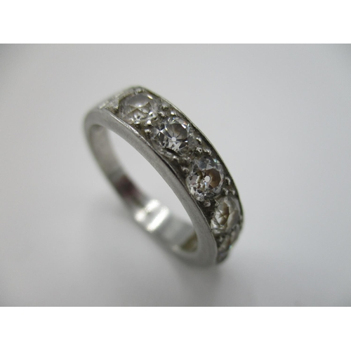 14 - A platinum and diamond half eternity ring set with seven brilliant cut diamonds, approx 1.3 carat to...
