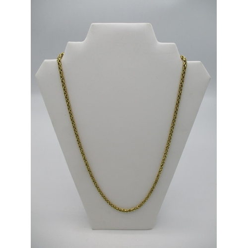 18 - A yellow gold coloured neck chain with scroll links stamped 750, 26