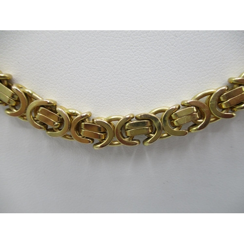 19 - A yellow gold neck chain with king braid/byzantine link, stamped 375 17 1/2