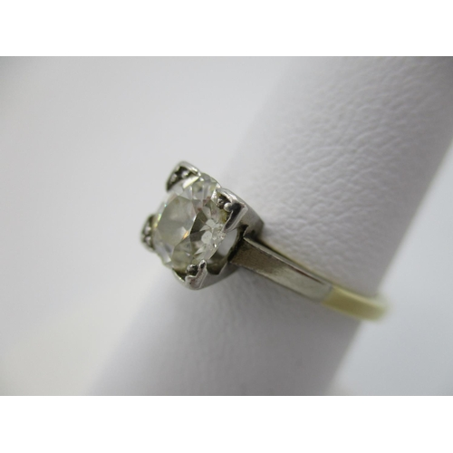 24 - A gold and platinum coloured metal claw set diamond, solitaire ring, approximately 1 carat, size M, ...