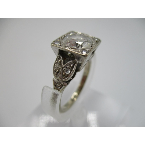 25 - An 18ct white gold, diamond solitaire ring, approximately 1 1/4 carat, in a square setting, surround...