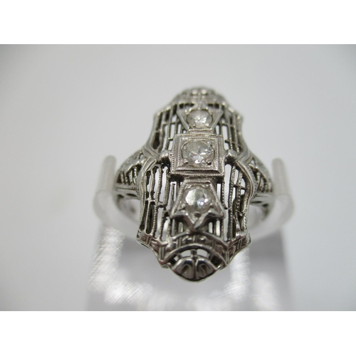 26 - An Art Deco white gold coloured dress ring set with three diamonds stamped 18 K, size L, total weigh...