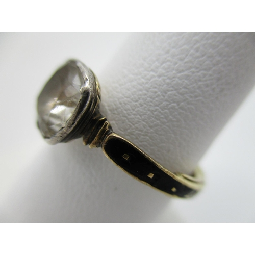 27 - A yellow gold coloured George III mourning ring set with a cushion shaped stone, possibly a white sa...