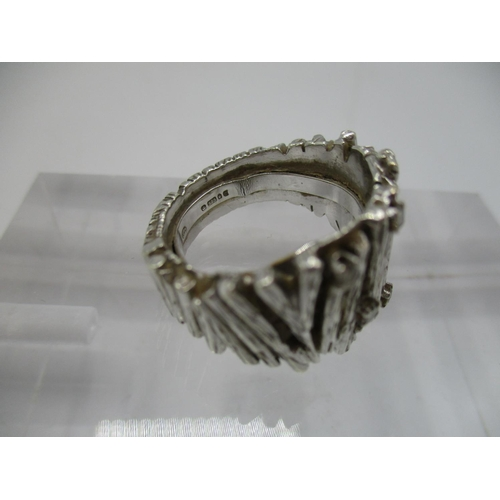 28 - A 9ct white gold dress ring with bark pattern inset with five diamonds, size L, total weight 12.25g...
