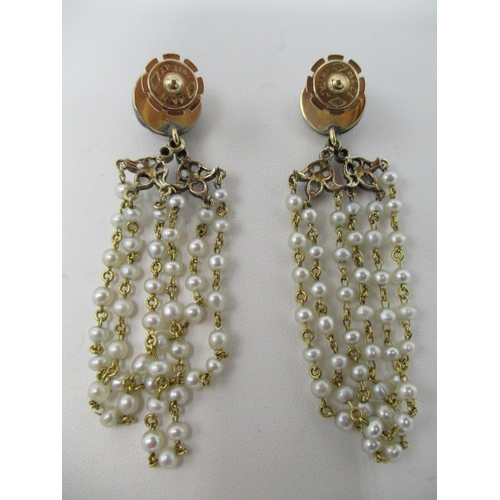 31 - A pair of Italian 18ct gold, diamond and three strand pearl earrings, 11.90 g...