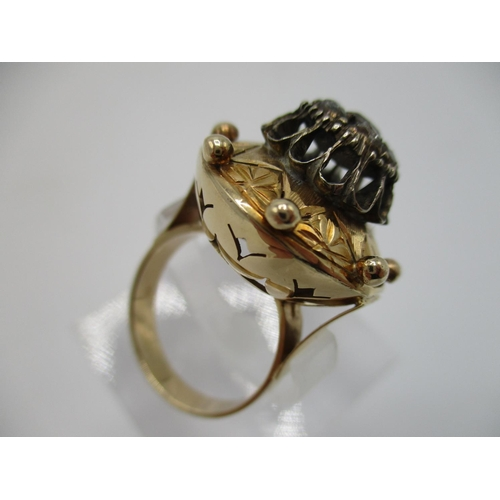 32 - A 19th century gold coloured metal and diamond ring, the domed top set with eight old mine cut diamo...