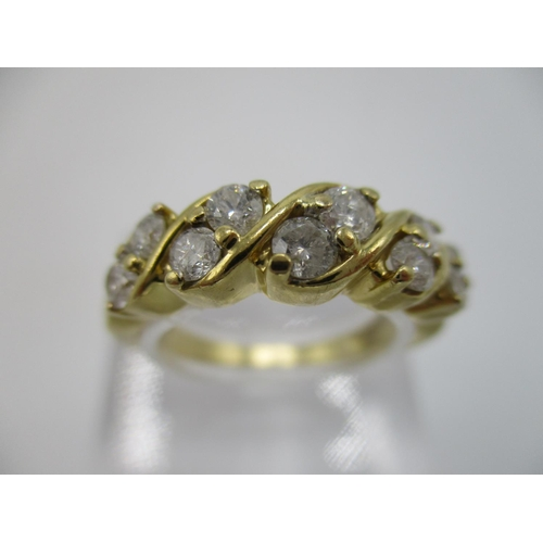 35 - A yellow gold coloured metal diamond half loop, eternity ring set with five pairs of diamonds in a t...