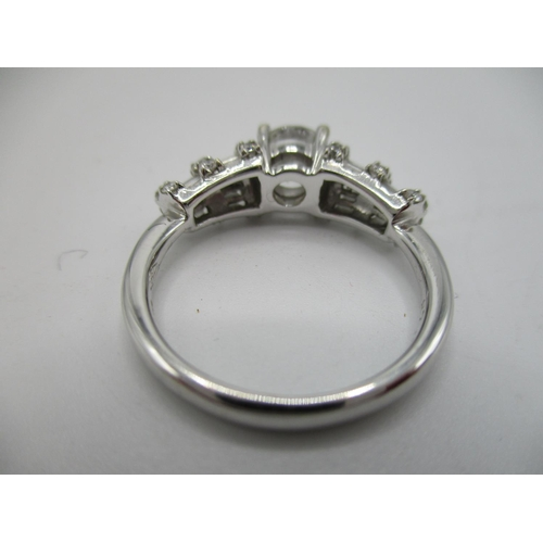 5 - An 18ct white gold and diamond ring with a central diamond 0.7ct, three diamond set bands inter-spac...