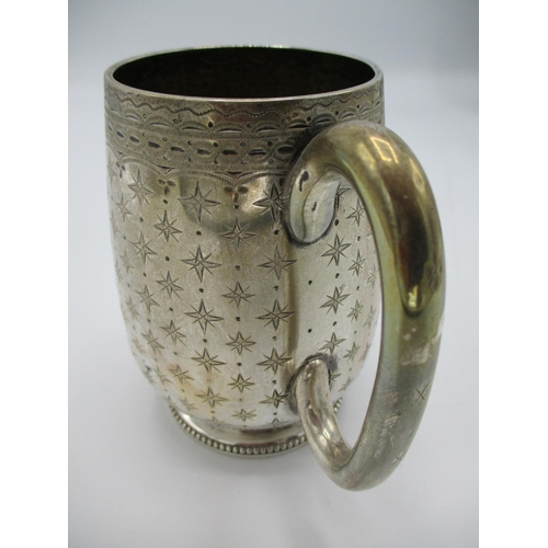 9 - A Victorian silver tankard, London 1874 by Richards and Brown (Edward Charles Brown) of bulbous form...