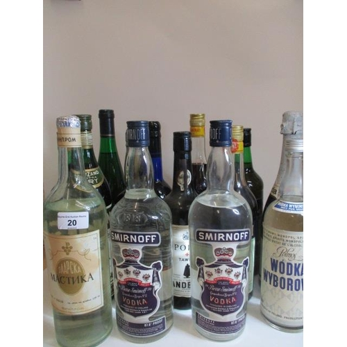 20 - A selection of four bottles of Vodka to include Smirnoff and ten further bottles to include Harveys ...