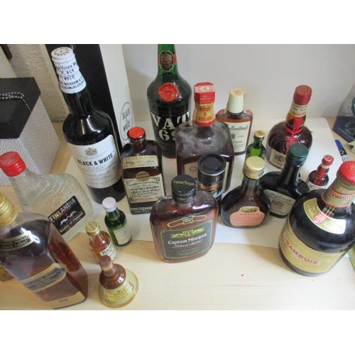 22 - A collection of twenty mixed bottles of spirits to include miniatures, Jamaican rum, whiskeys and Dr...