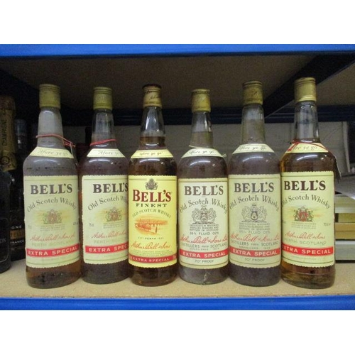 25 - Six bottles of Bells Finest Old Scotch Whisky 75cl and 70cl,26 2/3fl oz...