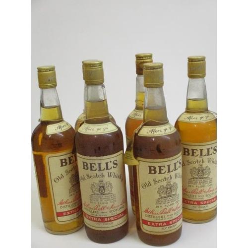 29 - Six bottles of Bells Old Scotch Whisky, 26 2/3 fl oz...