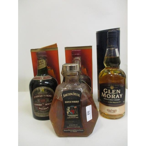 32 - Four bottles of Scotch Whisky to include Chivas Regal, Glen Moray and Something Special...