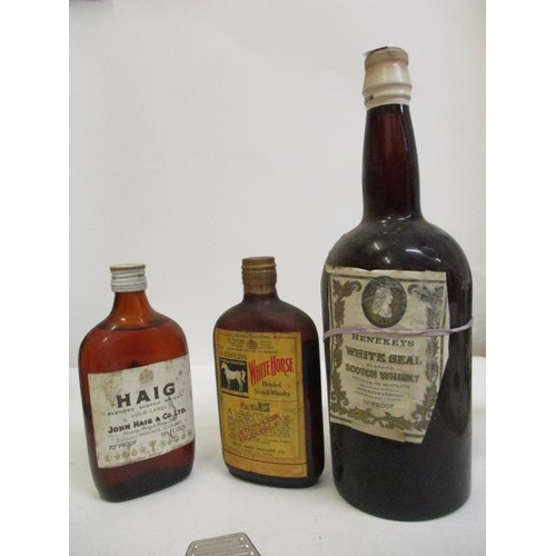35 - Three bottles of Scotch Whisky to include White Horse, Haig and Henekeys White Seal...