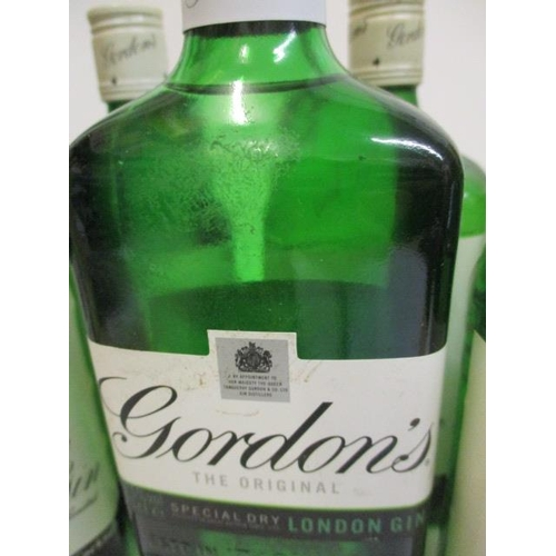 37 - Seven bottles of Gordons Special dry London Gin, 6 x 75cl, 1 x 70cl...