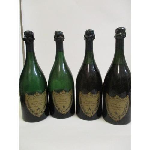 45 - Four bottles of Dom Perignon 1955, two bottles mid shoulder, A/F...