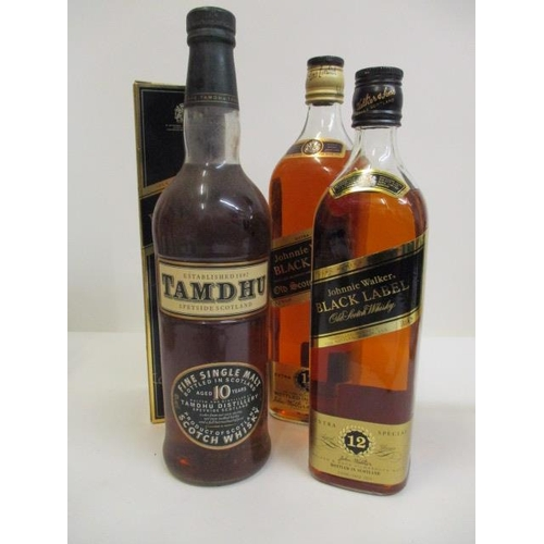54 - Three bottles of whisky to include Johnnie Walker black label, 70cl and 1lt and Tamoth single malt, ...