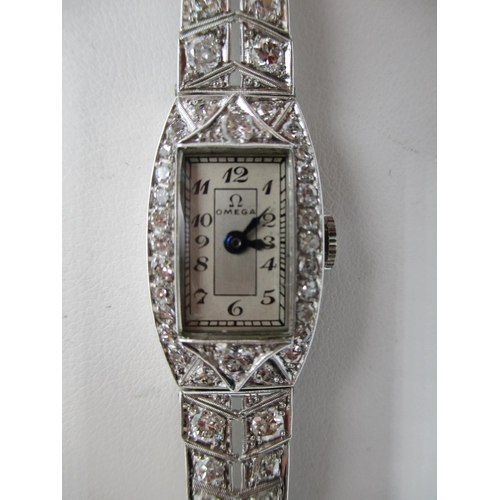 33 - An Omega white gold and diamond ladies wristwatch with rectangular dial with Arabic numerals, inset ...