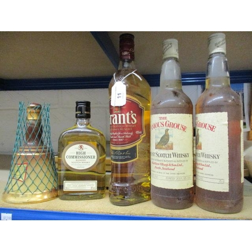11 - Five mixed bottles of Scotch Whisky to include The Famous Grouse 75cl, Grants 1lt, Bells and High Co...