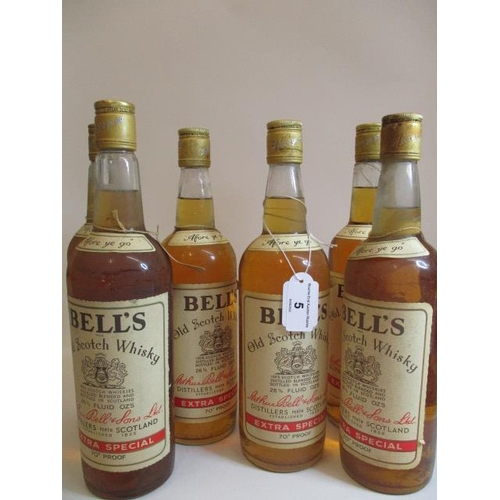 5 - Six 26 2/3 fl oz bottles of Bells Old Scotch Whisky...