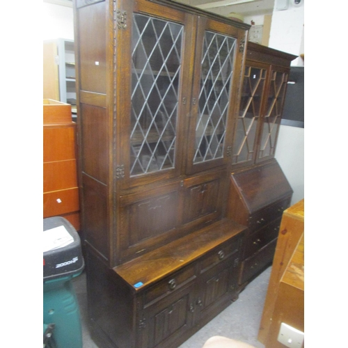 39 - A mid 20th century oak linenfold display cabinet, together with an early 20th century walnut cabinet...