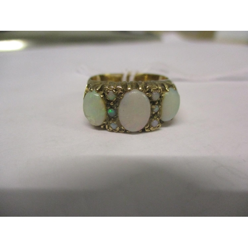2 - A 9ct gold and opal ring having three large opals and six small opals. Total weight 6.0g. Ring size ...