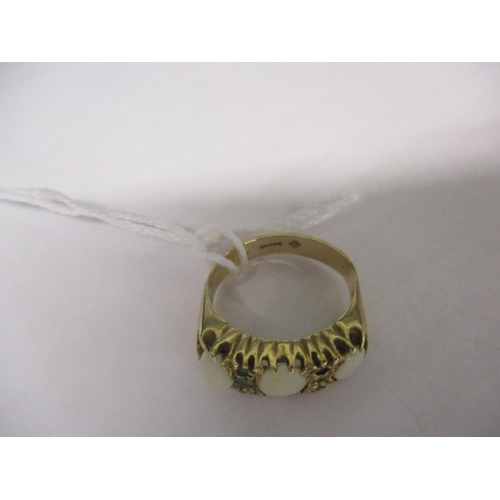 3 - A 9ct gold, opal and emerald ring having three large opals and six small emeralds. Total weight 4.9g...